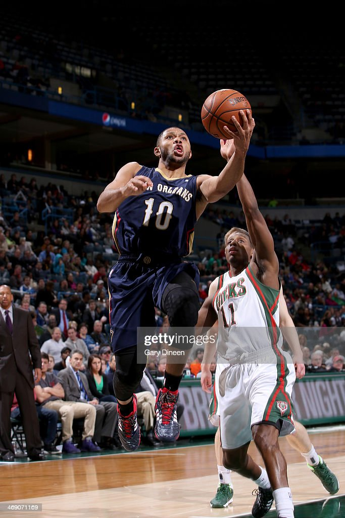 <a gi-track='captionPersonalityLinkClicked' href=/galleries/search?phrase=Eric+Gordon&family=editorial&specificpeople=4212733 ng-click='$event.stopPropagation()'>Eric Gordon</a> #10 of the New Orleans Pelicans shoots against Brandon Knight #11 of the Milwaukee Bucks on February 12, 2014 at the BMO Harris Bradley Center in Milwaukee, Wisconsin.