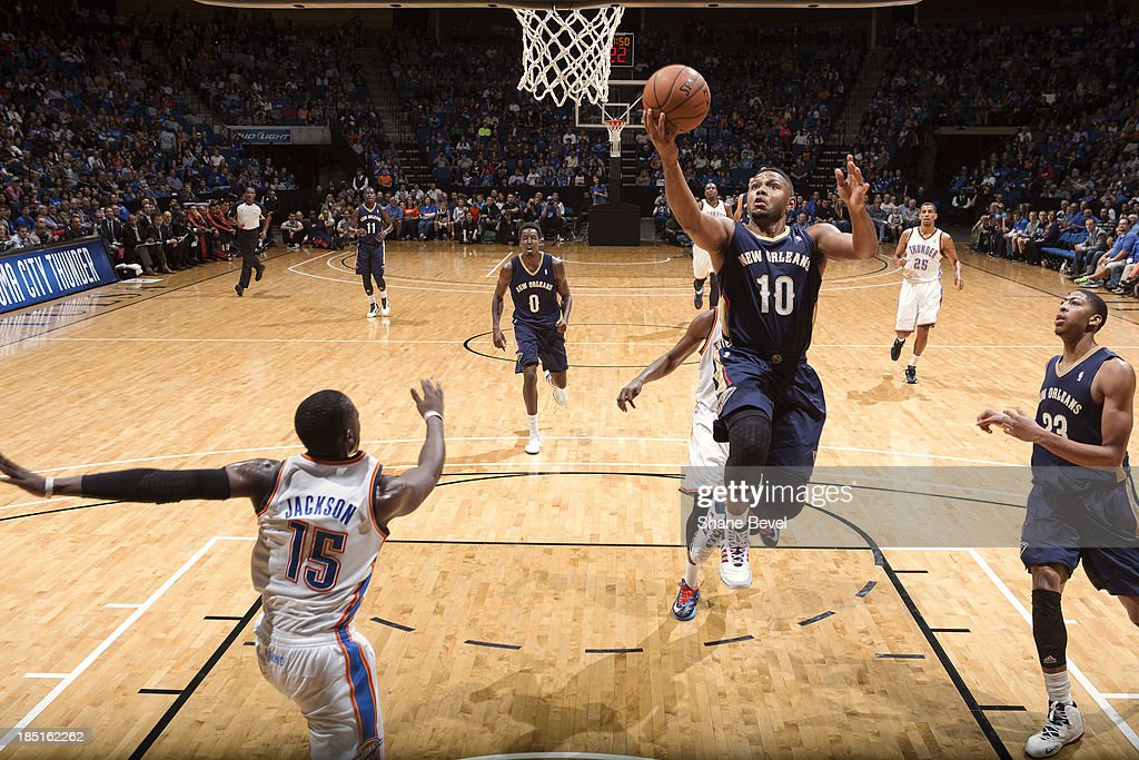 <a gi-track='captionPersonalityLinkClicked' href=/galleries/search?phrase=Eric+Gordon&family=editorial&specificpeople=4212733 ng-click='$event.stopPropagation()'>Eric Gordon</a> #10 of the New Orleans Pelicans shoots against Reggie Jackson #15 of the Oklahoma City Thunder during the NBA preseason game on October 17, 2013 at the BOK Center in Tulsa, Oklahoma.