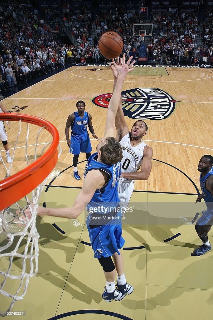 <a gi-track='captionPersonalityLinkClicked' href=/galleries/search?phrase=Eric+Gordon+-+Basketball+Player&family=editorial&specificpeople=4212733 ng-click='$event.stopPropagation()'>Eric Gordon</a> #10 of the New Orleans Pelicans shoots against the Dallas Mavericks on December 4, 2013 at the New Orleans Arena in New Orleans, Louisiana.