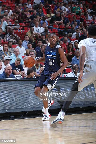 Eric Griffin of the Dallas Mavericks dribbles the ball against the Minnesota Timberwolves during the game at the Samsung NBA Summer League 2014 on...