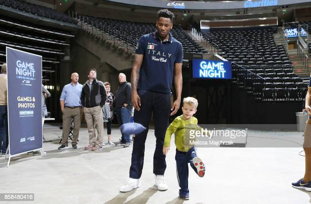 Eric Griffin of the Utah Jazz plays bean bag toss with a young fan during Game Night with the Jazz at vivintSmartHome Arena on October 05 2017 in...