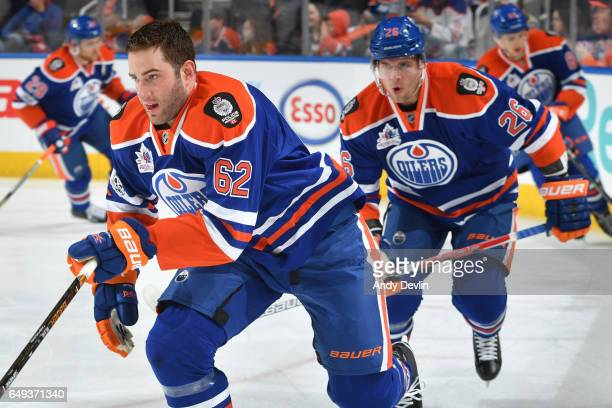 Eric Gryba and Iiro Pakarinen of the Edmonton Oilers warm up wearing jerseys honouring the 125th anniversary of the Edmonton Police Service prior to...
