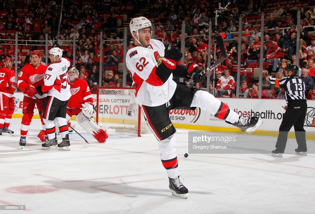 <a gi-track='captionPersonalityLinkClicked' href=/galleries/search?phrase=Eric+Gryba&family=editorial&specificpeople=570539 ng-click='$event.stopPropagation()'>Eric Gryba</a> #62 of the Ottawa Senators celebrates his first period goal while playing the Detroit Red Wings at Joe Louis Arena on October 23, 2013 in Detroit, Michigan.