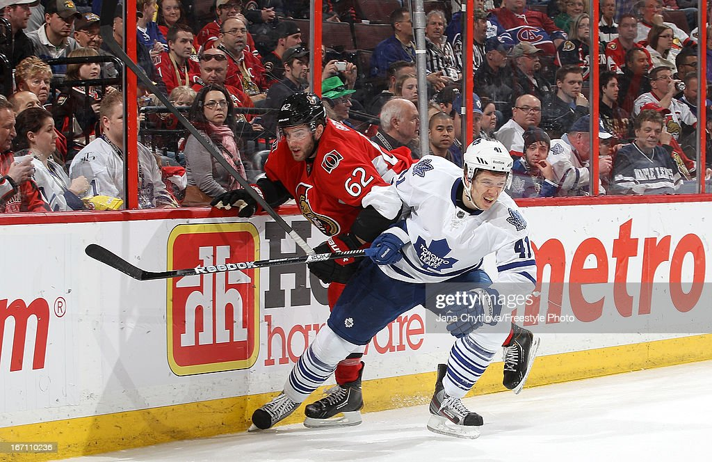 <a gi-track='captionPersonalityLinkClicked' href=/galleries/search?phrase=Eric+Gryba&family=editorial&specificpeople=570539 ng-click='$event.stopPropagation()'>Eric Gryba</a> #62 of the Ottawa Senators collides with <a gi-track='captionPersonalityLinkClicked' href=/galleries/search?phrase=Nikolai+Kulemin&family=editorial&specificpeople=537949 ng-click='$event.stopPropagation()'>Nikolai Kulemin</a> #41 of the Toronto Maple Leafs during an NHL game, at Scotiabank Place, on April 20, 2013 in Ottawa, Ontario, Canada.