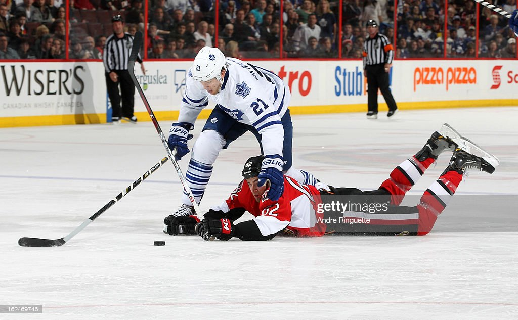 Eric Gryba #62 of the Ottawa Senators dives to negate a breakaway opportunity for James van Riemsdyk #21 of the Toronto Maple Leafs on February 23, 2013 at Scotiabank Place in Ottawa, Ontario, Canada.