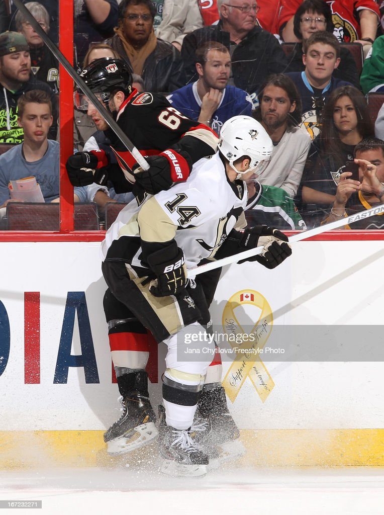 <a gi-track='captionPersonalityLinkClicked' href=/galleries/search?phrase=Eric+Gryba&family=editorial&specificpeople=570539 ng-click='$event.stopPropagation()'>Eric Gryba</a> #62 of the Ottawa Senators gets checked by <a gi-track='captionPersonalityLinkClicked' href=/galleries/search?phrase=Chris+Kunitz&family=editorial&specificpeople=604159 ng-click='$event.stopPropagation()'>Chris Kunitz</a> #14 of the Pittsburgh Penguins during an NHL game at Scotiabank Place, on April 22, 2013 in Ottawa, Ontario, Canada.