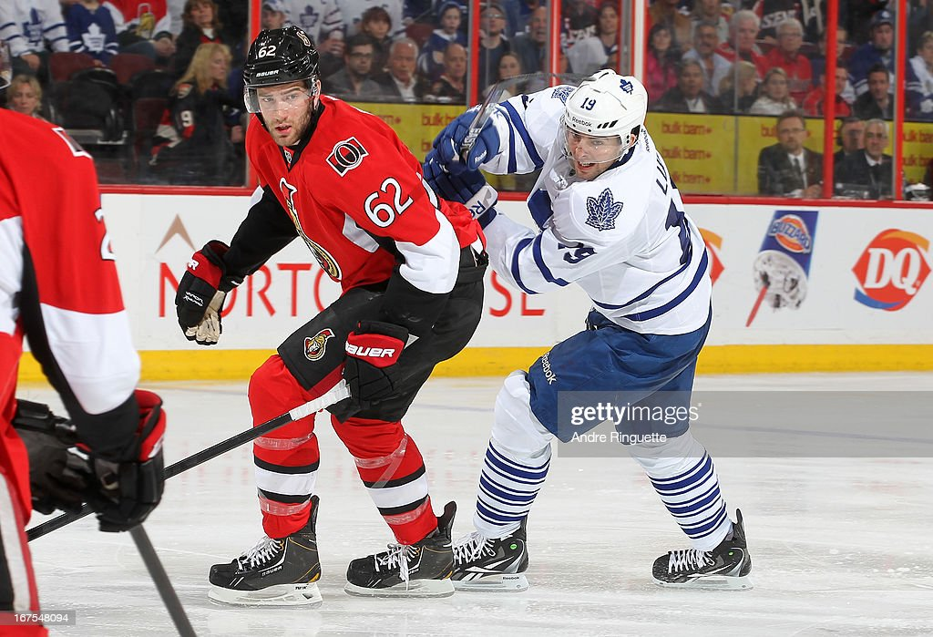 Eric Gryba #62 of the Ottawa Senators skates against Joffrey Lupul #19 of the Toronto Maple Leafs on April 20, 2013 at Scotiabank Place in Ottawa, Ontario, Canada.
