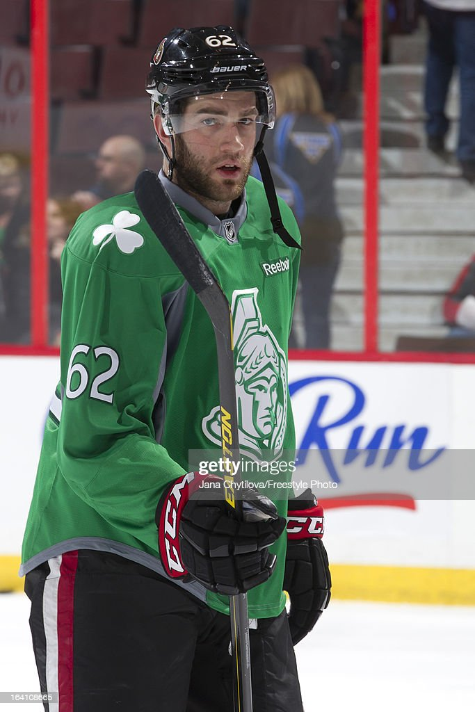 Eric Gryba #62 of the Ottawa Senators wears a green jersey to celebrate Saint Patrick's Day, during warmups prior to an NHL game against the Winnipeg Jets at Scotiabank Place on March 17, 2013 in Ottawa, Ontario, Canada.