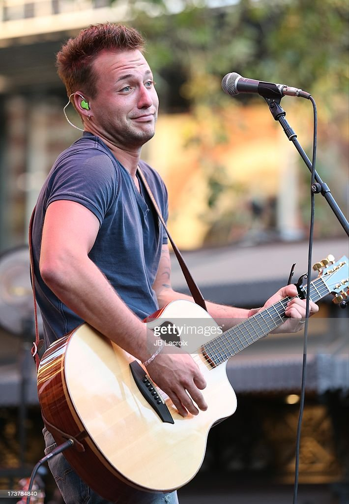 Eric Gunderson of Love And Theft performs at The Grove on July 17, 2013 in Los Angeles, California.