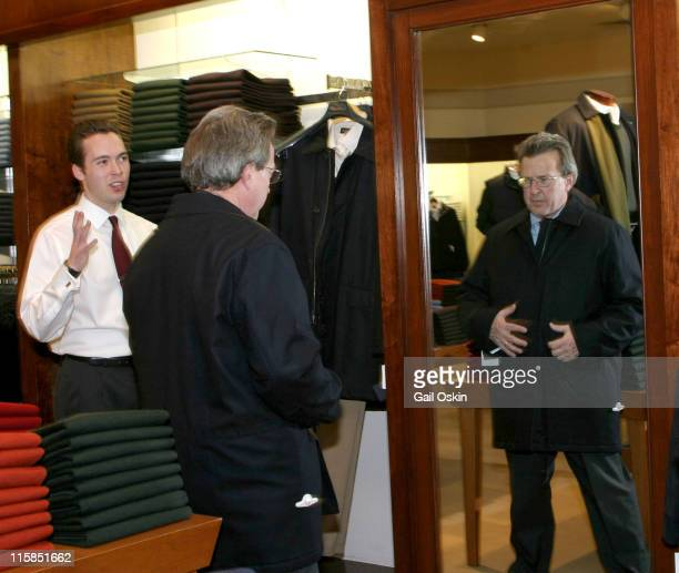 Eric Hanser left sales associate assists customer John Bishop of Boston in picking out an overcoat during the 185th Anniversary celebration at the...