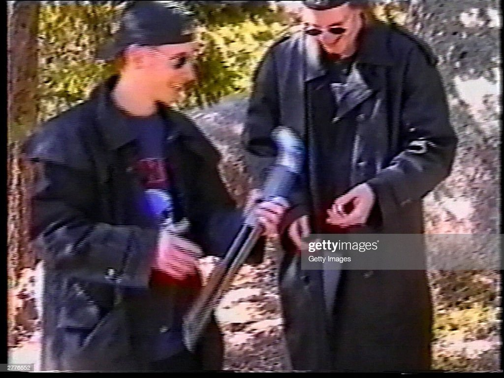Eric Harris and Dylan Klebold examine a sawedoff shotgun at a makeshift shooting range March 6 1999 in Douglas County CO in this image from video...