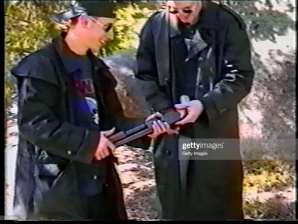 Eric Harris (L) and Dylan Klebold examine a sawed-off shotgun at a makeshift shooting range March 6, 1999 in Douglas County, CO in this image from video released by the Jefferson County Sheriff's Department. Approximately six weeks after this video was made, Klebold and Harris killed 13 people at Columbine High School in Littleton, CO in the worst school shooting in U.S. history. Some of the weapons seen in the video were used in the shooting.