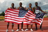 Eric Harris Charles Silmom Michael Granger and Oliver Bradwell of the United States celebrate their victory in the Men's 4x100 Metre Relay Final on...