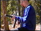 Eric Harris handles a weapon at a makeshift shooting range March 6 1999 in Douglas County CO in this image from video released by the Jefferson...