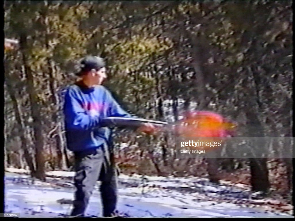 Eric Harris practices shooting a gun at a makeshift shooting range March 6 1999 in Douglas County CO in this image from video released by the...