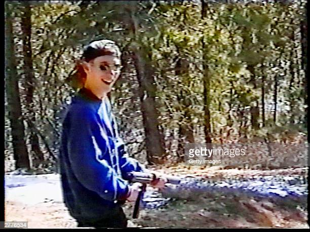 Eric Harris practices shooting a weapon at a makeshift shooting range March 6 1999 in Douglas County CO in this image from video released by the...