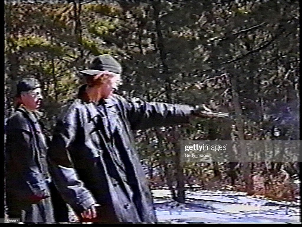 Eric Harris watches as Dylan Klebold practices shooting a gun at a makeshift shooting range March 6 1999 in Douglas County CO in this image from...