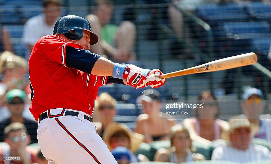 <a gi-track='captionPersonalityLinkClicked' href=/galleries/search?phrase=Eric+Hinske&family=editorial&specificpeople=213156 ng-click='$event.stopPropagation()'>Eric Hinske</a> #20 of the Atlanta Braves hits a two-run double in the eighth inning against the Kansas City Royals at Turner Field on June 20, 2010 in Atlanta, Georgia.