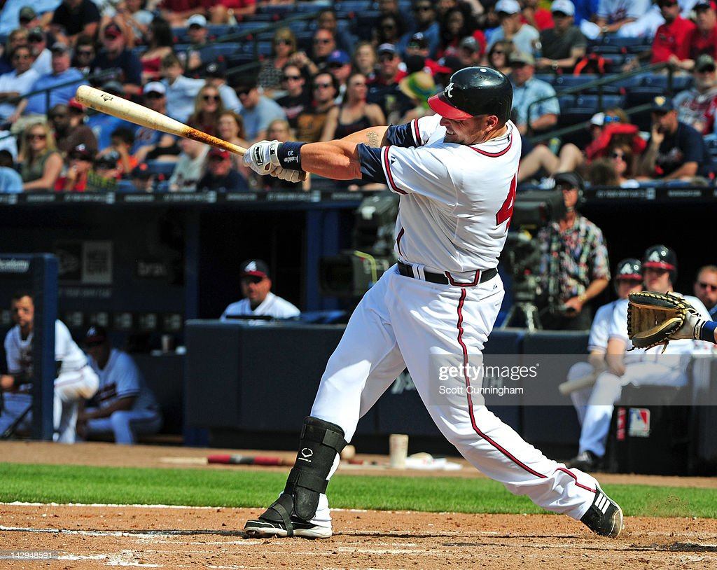 <a gi-track='captionPersonalityLinkClicked' href=/galleries/search?phrase=Eric+Hinske&family=editorial&specificpeople=213156 ng-click='$event.stopPropagation()'>Eric Hinske</a> of the Atlanta Braves pinch hits to knock in two runs against the Milwaukee Brewers at Turner Field on April 15, 2012 in Atlanta, Georgia. All uniformed team members are wearing jersey number 42 in honor of Jackie Robinson Day.