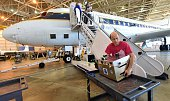 Eric Hintsa of NASA helps with loading equipment into NASA's highly modified Douglas DC8 jetliner which operates as a flying science at the Armstrong...