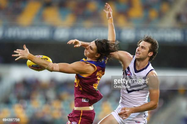 Eric Hipwood of the Lions and Joel Hamling of the Dockers compete for the ball during the round 12 AFL match between the Brisbane Lions and the...