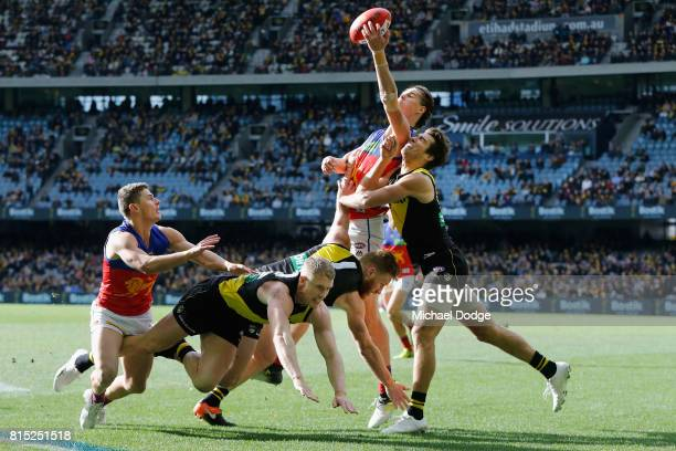 Eric Hipwood of the Lions competes for the ball over Alex Rance of the Tigers during the round 17 AFL match between the Richmond Tigers and the...