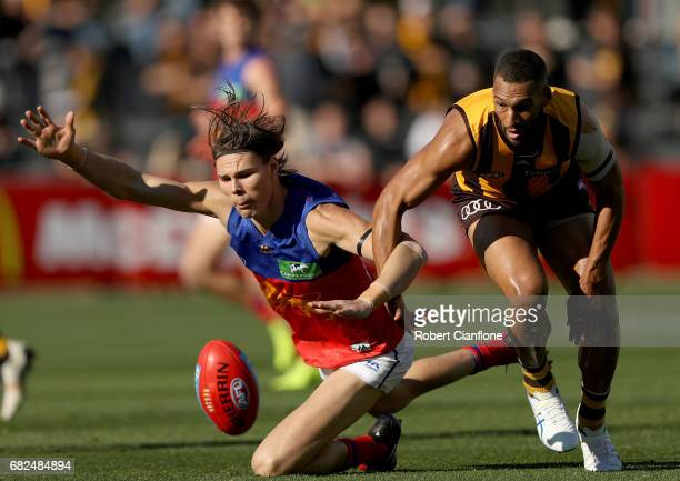 Eric Hipwood of the Lions is challenged by Josh Gibson of the Hawks during the round eight AFL match between the Hawthorn Hawks and the Brisbane...