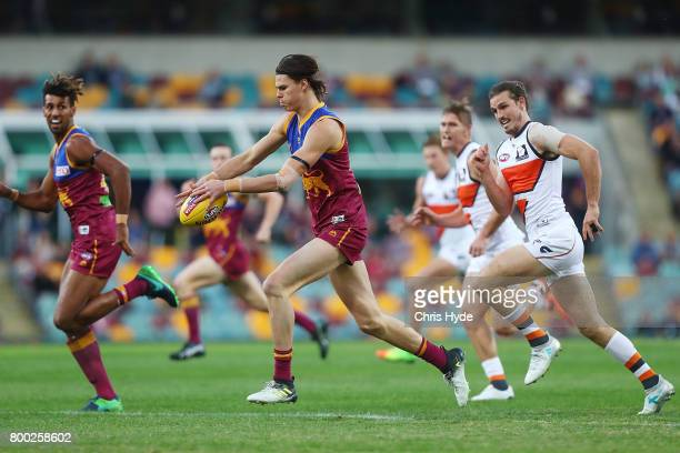 Eric Hipwood of the Lions runs the ball during the round 14 AFL match between the Brisbane Lions and the Greater Western Sydney Giants at The Gabba...