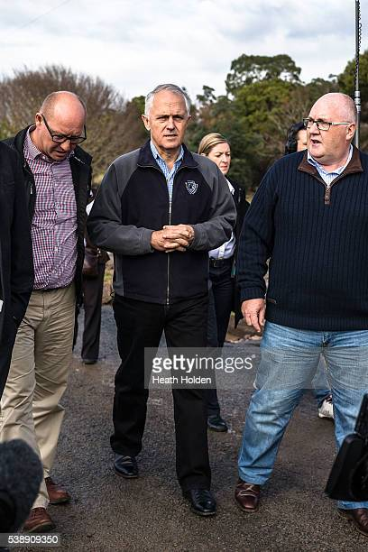 Eric Hitchinson Prime Minister Malcolm Turnbull and Brett Whiteley visit the flood devestated areas in NW Tasmania on June 9 2016 in Devonport...