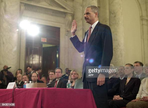 Eric Holder is sworn in during his confirmation hearing in front of the Senate Judiciary Committee on Capitol Hill on January 15 2009 in Washington...