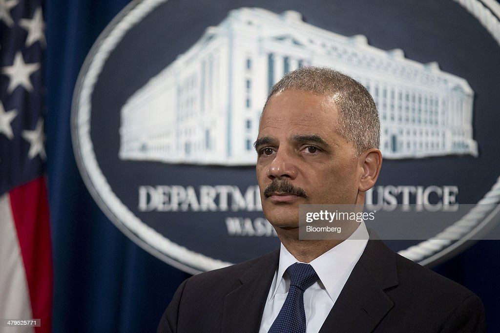 <a gi-track='captionPersonalityLinkClicked' href=/galleries/search?phrase=Eric+Holder&family=editorial&specificpeople=1060367 ng-click='$event.stopPropagation()'>Eric Holder</a>, U.S. attorney general, listens during a news conference at the Department of Justice in Washington, D.C., U.S., on Wednesday, March 19, 2014. Toyota Motor Corp. has agreed to pay a $1.2 billion penalty to end a U.S. criminal probe into sudden unintended acceleration that led to the recall of more than 10 million vehicles, the Justice Department said. Photographer: Andrew Harrer/Bloomberg via Getty Images
