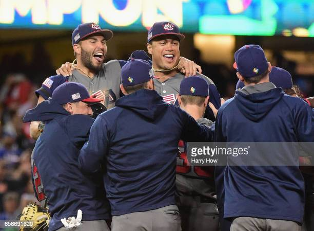 Eric Hosmer and Giancarlo Stanton of team United States celebrate with teammates after their 80 win over team Puerto Rico during Game 3 of the...