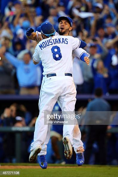 Eric Hosmer and Mike Moustakas of the Kansas City Royals celebrate their 2 to 1 win over the Baltimore Orioles to sweep the series in Game Four of...