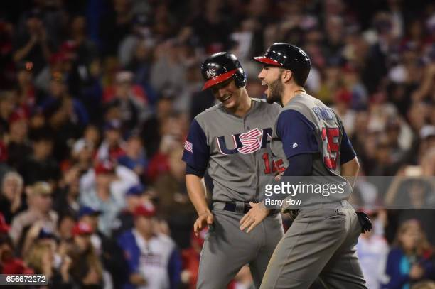 Eric Hosmer and Nolan Arenado of team United States celebrates their two runs making it 60 in the seventh inning against team Puerto Rico during Game...