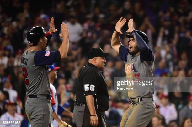 Eric Hosmer and Nolan Arenado of team United States celebrates their tworun single by Brandon Crawford for a score of 60 in the seventh inning...