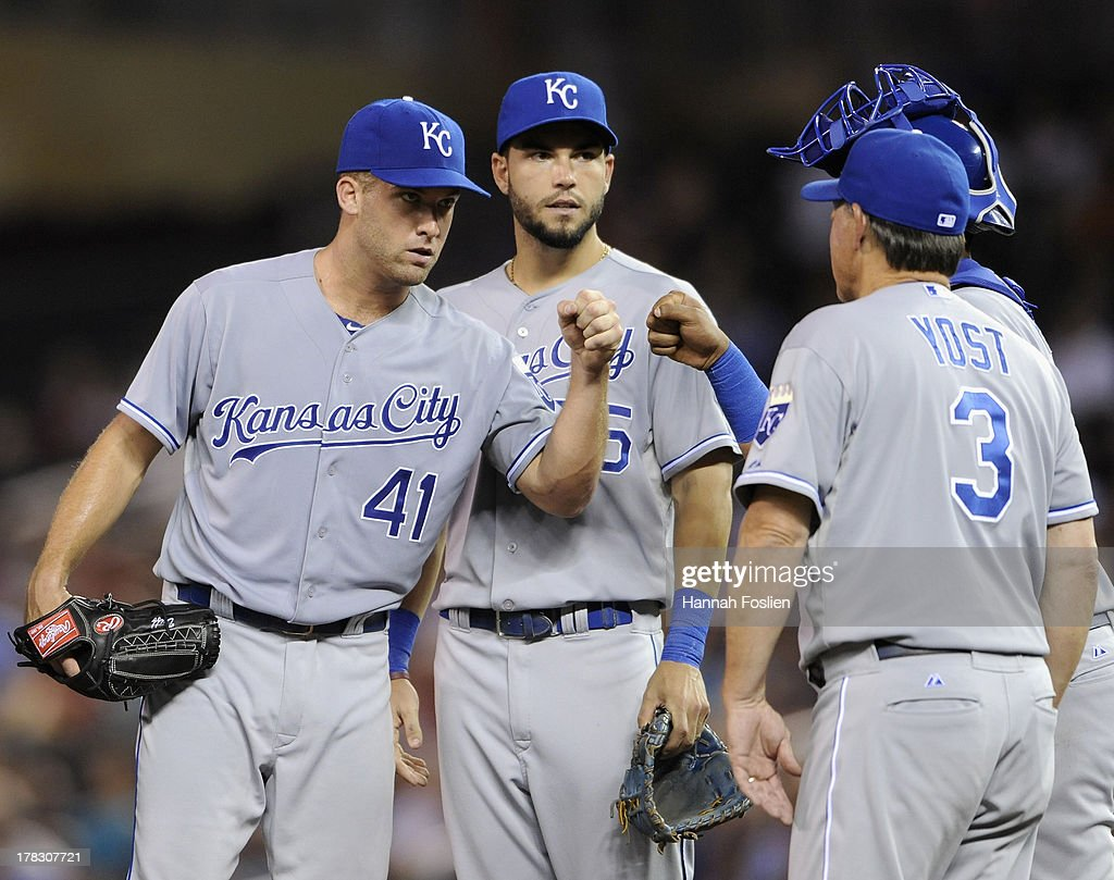 Eric Hosmer #35 and Salvador Perez #13 of the Kansas City Royals congratulate starting pitcher Danny Duffy #41 as manager Ned Yost #3 takes Duffy out of the game against the Minnesota Twins during the seventh inning on August 28, 2013 at Target Field in Minneapolis, Minnesota. The Royals defeated the Twins 8-1.