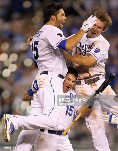 Eric Hosmer Matt Treanor and Chris Getz of the Kansas City Royals celebrate after Hosmer knocked in the gamewinning run during the bottom of the 10th...