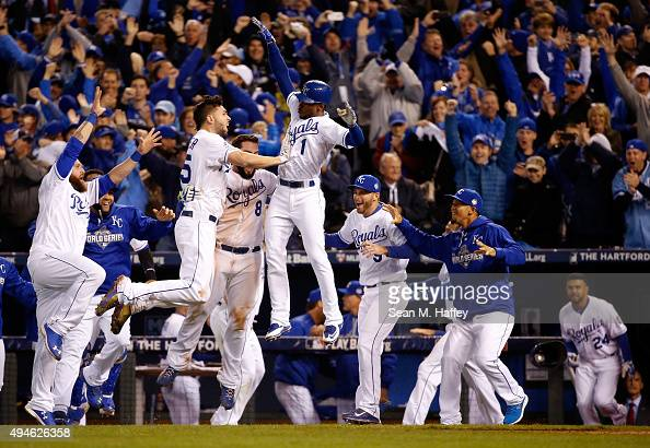 Eric Hosmer Mike Moustakas and Jarrod Dyson of the Kansas City Royals celebrate the Royals 54 in 14 innings against the New York Mets during Game One...