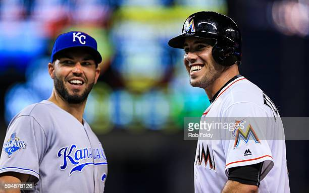 Eric Hosmer of the Kansas City Royals and Jose Fernandez of the Miami Marlins smile from first base during the game at Marlins Park on August 24 2016...