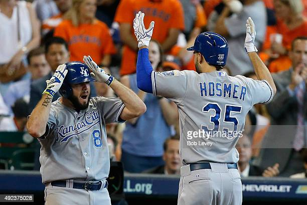 Eric Hosmer of the Kansas City Royals celebrates a tworun home run in the ninth inning with Mike Moustakas against the Houston Astros during game...