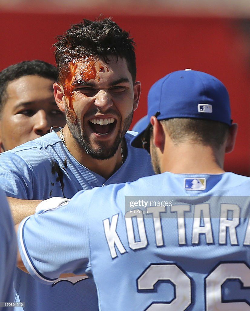 Eric Hosmer #35 of the Kansas City Royals celebrates his game-winning RBI single with George Kottaras #26 in the 10th inning during a game against the Detroit Tigers at Kauffman Stadium on June 12, 2013 in Kansas City, Missouri. The Royals won 3-2.