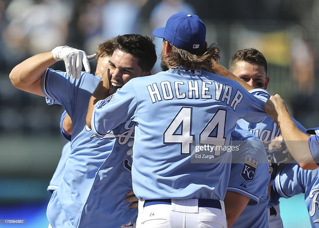 Eric Hosmer #35 of the Kansas City Royals celebrates his game-winning RBI single with Luke Hochevar #44 and teammates in the 10th inning during a game against the Detroit Tigers at Kauffman Stadium on June 12, 2013 in Kansas City, Missouri. The Royals on 3-2.