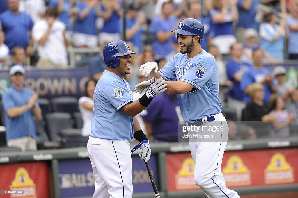 Eric Hosmer #35 of the Kansas City Royals celebrates his home run with Brayan Pena #27 as he returns to the dugout after rounding the bases in the game against the Oakland Athletics on June 3, 2012 at Kauffman Stadium in Kansas City, Missouri. The Kansas City Royals defeated the Oakland Athletics 2-0.
