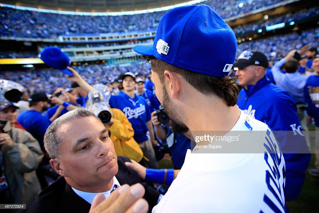 Eric Hosmer #35 of the Kansas City Royals celebrates with General Manager Dayton Moore after their 2 to 1 win over the Baltimore Orioles to sweep the series in Game Four of the American League Championship Series at Kauffman Stadium on October 15, 2014 in Kansas City, Missouri.