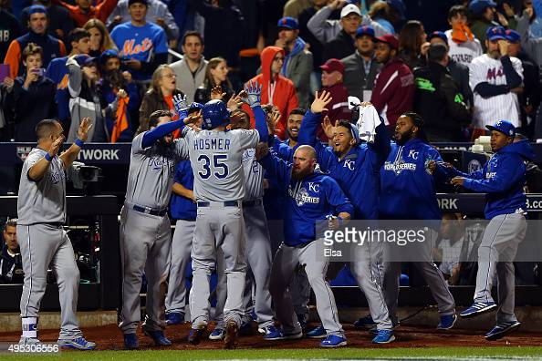 Eric Hosmer of the Kansas City Royals celebrates with his teammates after scoring a run off of a grounded out hit by Salvador Perez to tie the game...