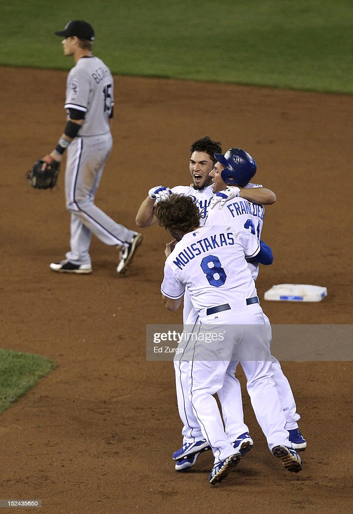<a gi-track='captionPersonalityLinkClicked' href=/galleries/search?phrase=Eric+Hosmer&family=editorial&specificpeople=7091345 ng-click='$event.stopPropagation()'>Eric Hosmer</a> #35 of the Kansas City Royals celebrates with <a gi-track='captionPersonalityLinkClicked' href=/galleries/search?phrase=Jeff+Francoeur&family=editorial&specificpeople=217574 ng-click='$event.stopPropagation()'>Jeff Francoeur</a> #21 and <a gi-track='captionPersonalityLinkClicked' href=/galleries/search?phrase=Mike+Moustakas&family=editorial&specificpeople=6780077 ng-click='$event.stopPropagation()'>Mike Moustakas</a> #8 after hitting a game-winning RBI single against the Chicago White Sox at Kauffman Stadium on September 20, 2012 in Kansas City, Missouri. The Royals won 4-3.
