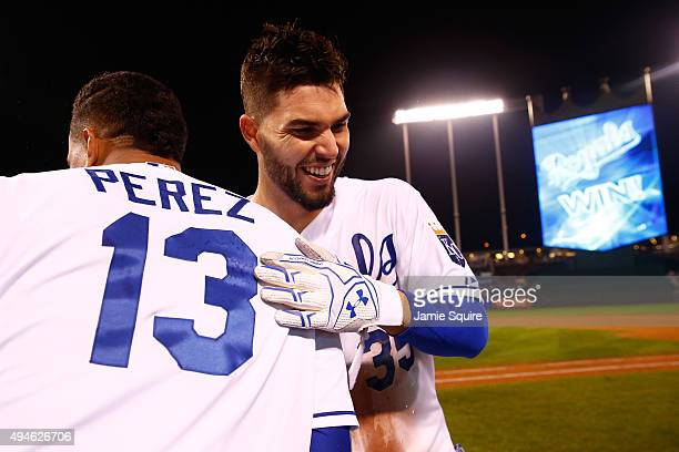 Eric Hosmer of the Kansas City Royals celebrates with Salvador Perez of the Kansas City Royals after defeating the New York Mets 54 in Game One of...