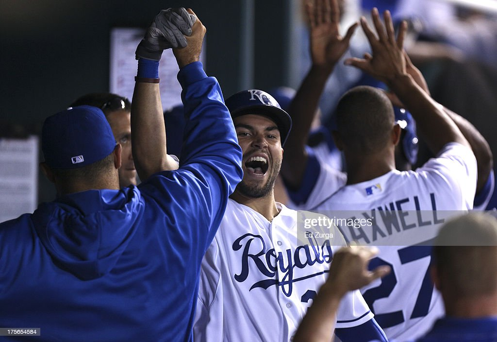 Eric Hosmer #35 of the Kansas City Royals celebrates with teammates after hitting a three-run home run in the sixth inning against the Minnesota Twins at Kauffman Stadium August, 5, 2013 in Kansas City, Missouri.