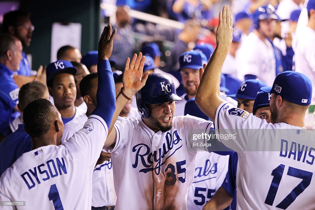 Eric Hosmer of the Kansas City Royals celebrates with treammates after scoring on a wild pitch in the eighth inning during their American League Wild...