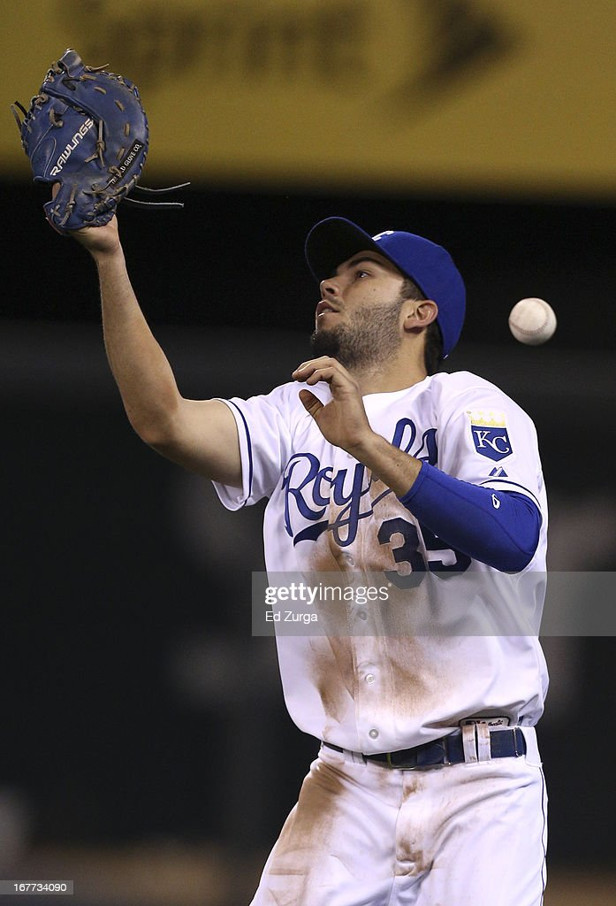 <a gi-track='captionPersonalityLinkClicked' href=/galleries/search?phrase=Eric+Hosmer&family=editorial&specificpeople=7091345 ng-click='$event.stopPropagation()'>Eric Hosmer</a> #35 of the Kansas City Royals drops a foul ball hit by Nick Swisher of the Cleveland Indians in the seventh inning during game two of a doubleheader at Kauffman Stadium on April 28, 2013 in Kansas City, Missouri.